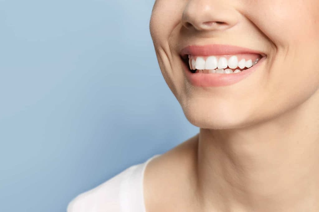 Lady with white teeth showing off her smile