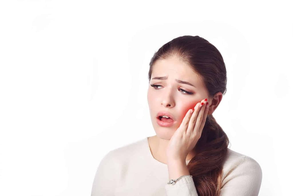 a girl with tooth ache