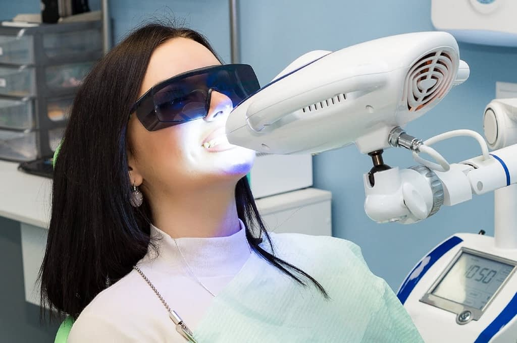 girl doing teeth whitening