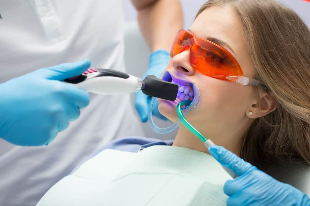 lady having teeth whitening treatment