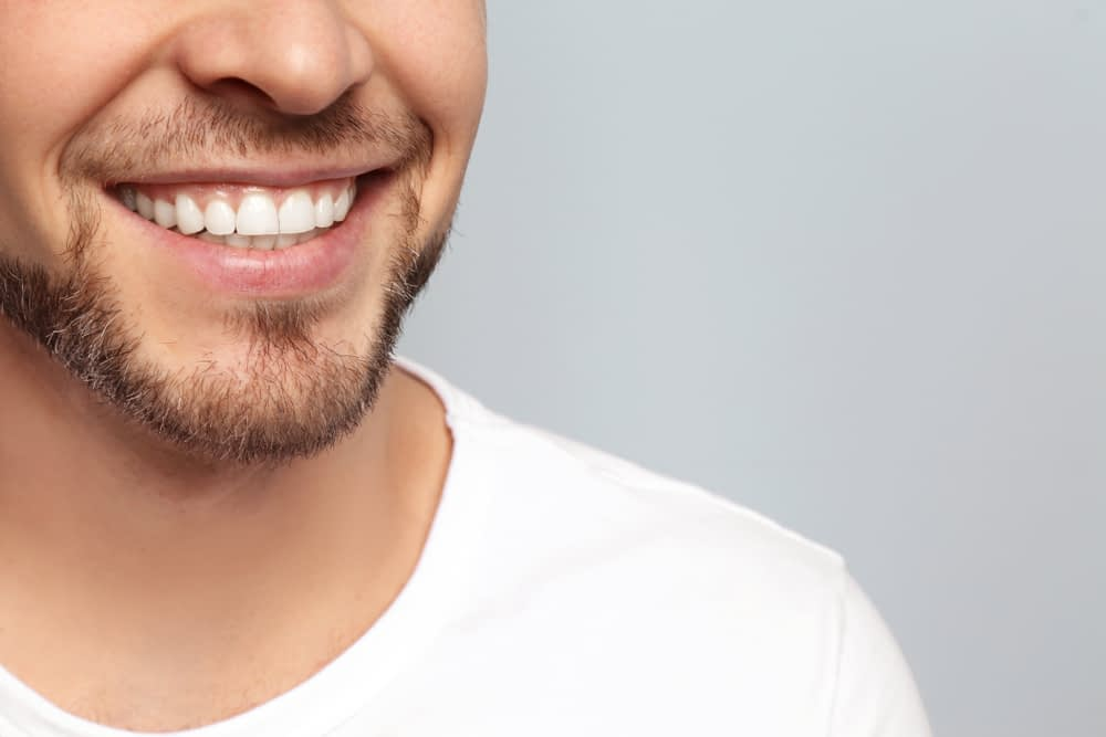 a man with natural white teeth