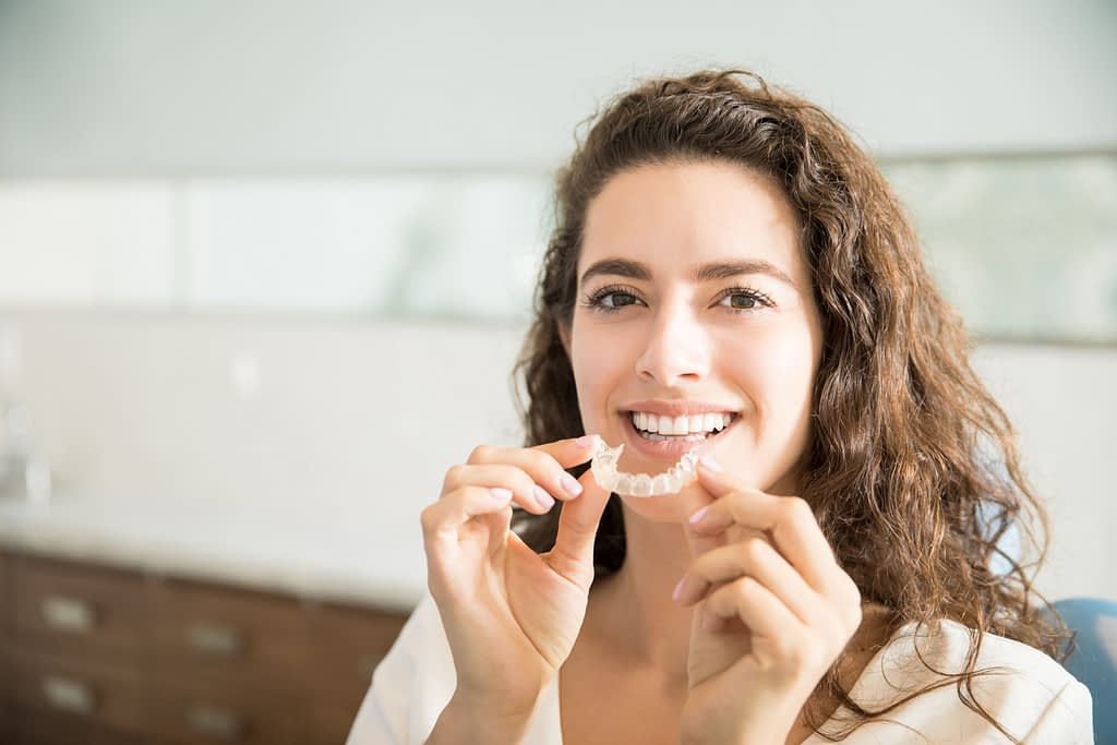 Lady smiling with upper mouthguard