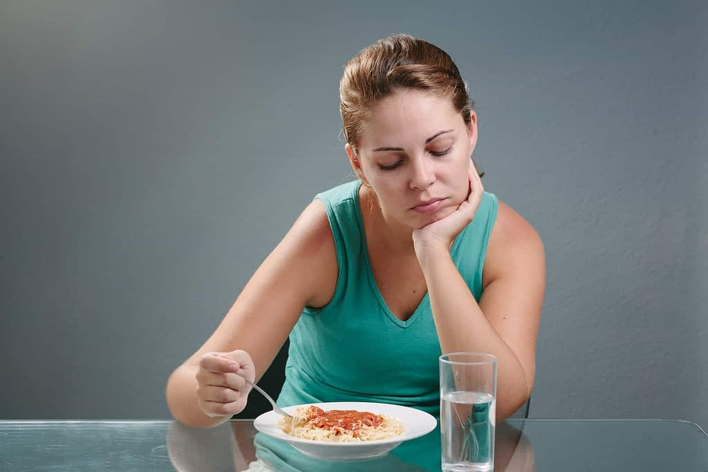 Lady eating a food as part of a balanced diet