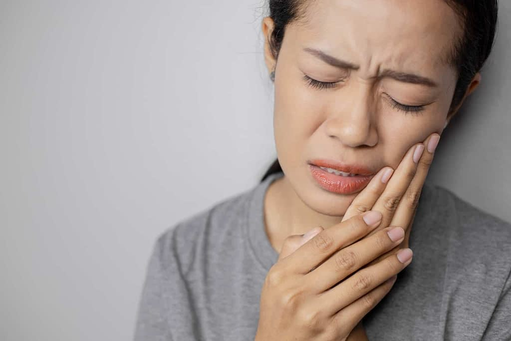 a woman with tooth ache
