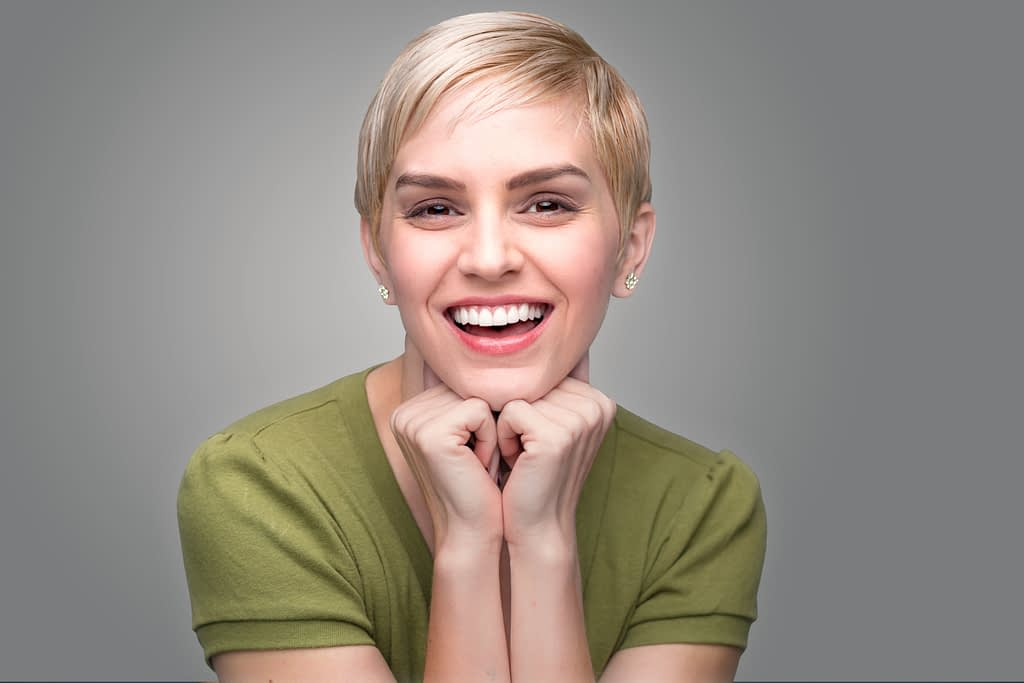 a lady with natural white teeth